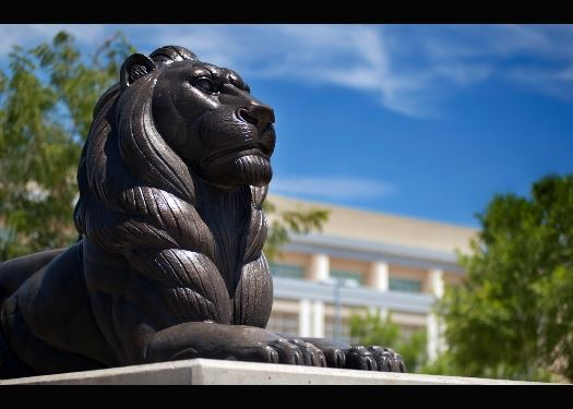 An undated photo of one of the lion statues in front of Las Cruces City Hall