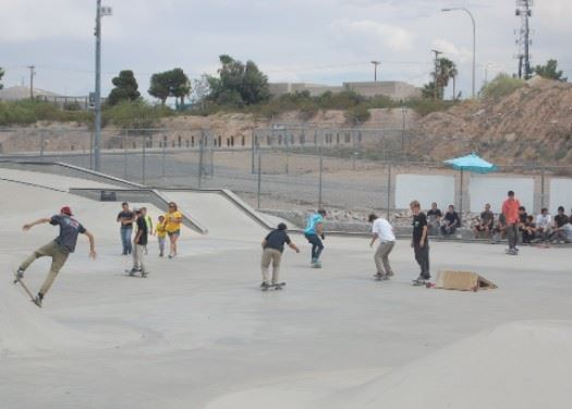young adults skate boarding
