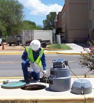 Worker treating sewer water
