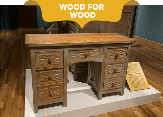 Colonial desk carved in solid wood